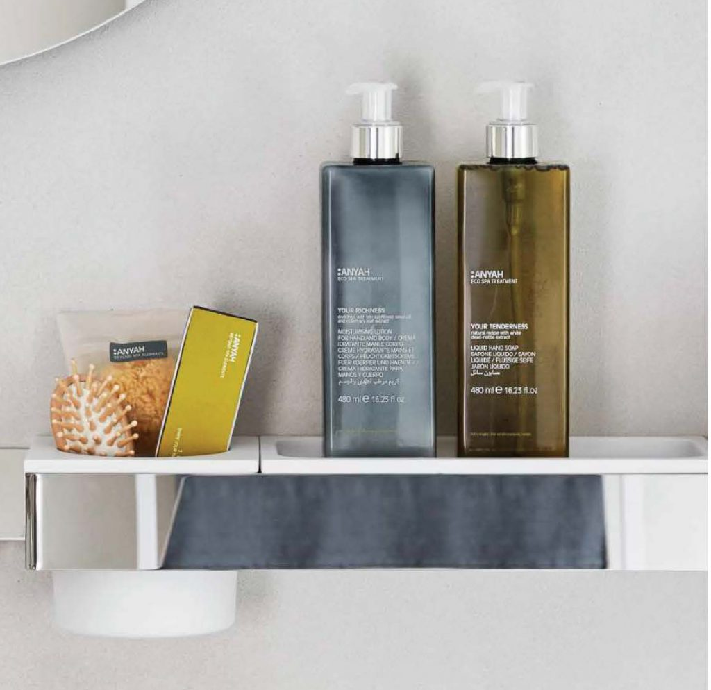 Anya dispensers on bathroom shelf