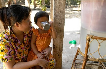 Cambodia ceramic water purifying image of young girl