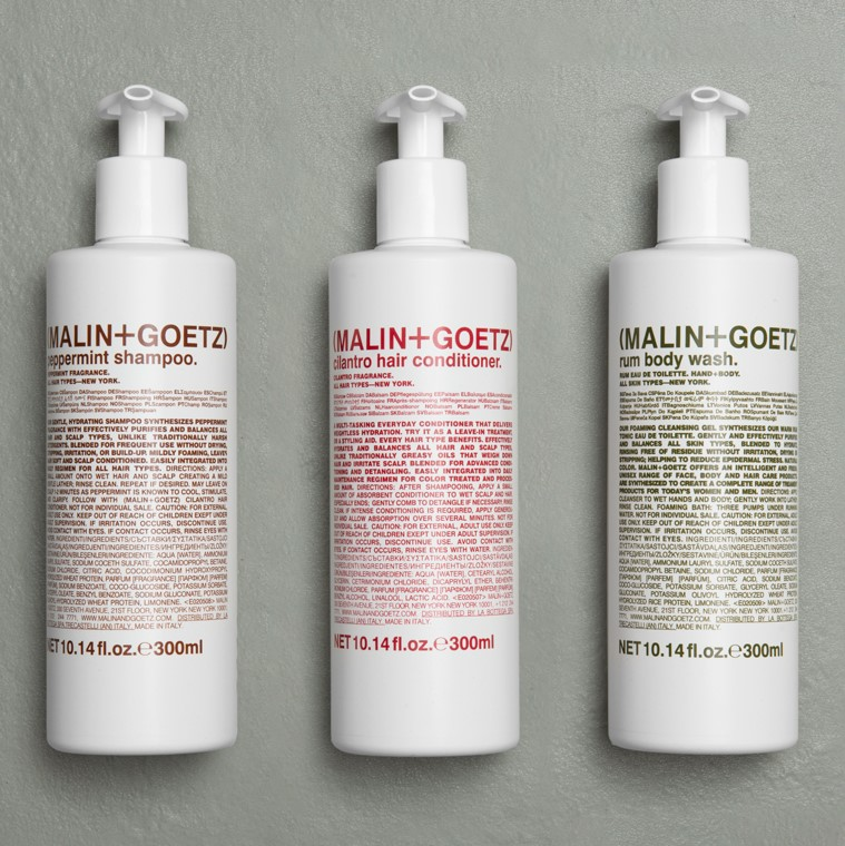 Malin + Goetz modern skincare solutions for hotels in pump bottles with invisible brackets